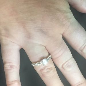 CZ solitaire ring on crisscross band in silver